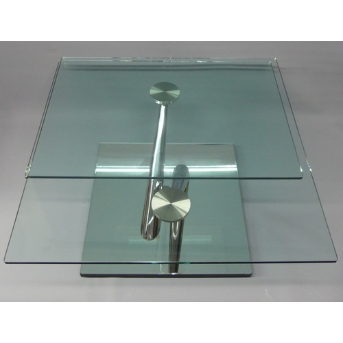 302 - A Naos Italian design chrome and glass two rotating tier coffee table of quality. 84 cm when closed ...