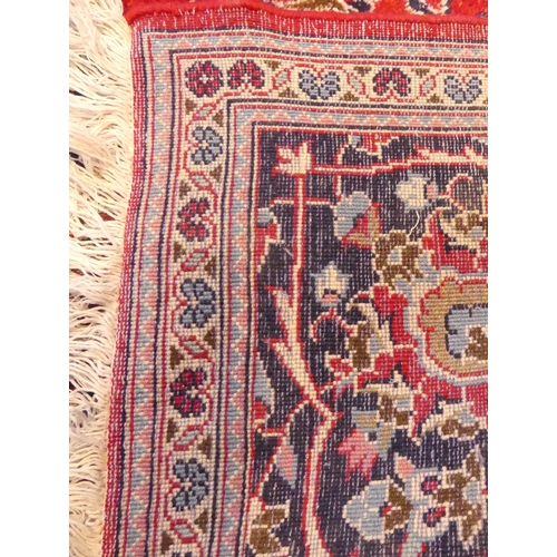 330 - Rich red ground Persian Kashan carpet floral medallion design. 295 x 195 cm.