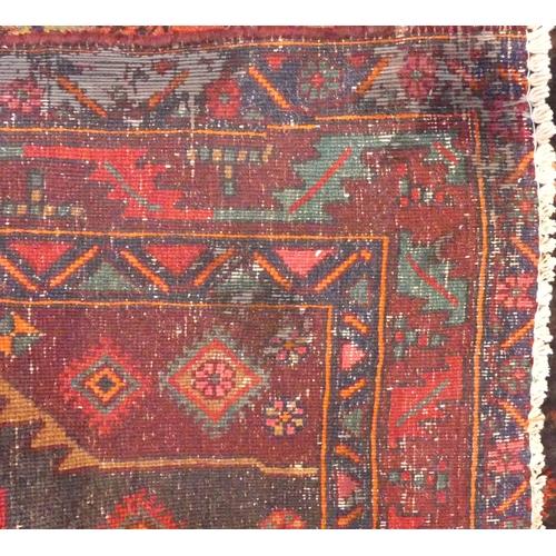 331 - Heavy pile Iranian Naravan carpet with animal motif designs 300 x 130 cm. UK Postage £30.