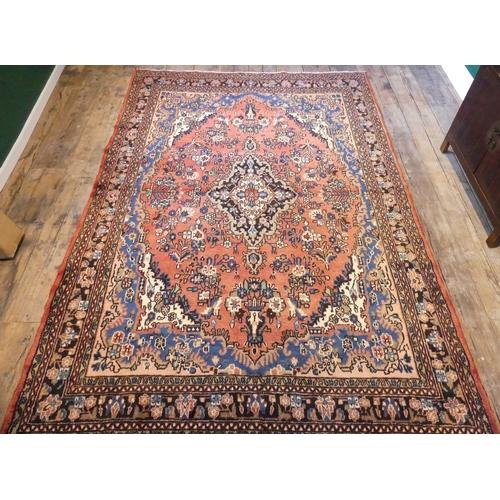 332 - Full pile washed red ground Persian Sarouk floral design carpet. 320 x 210 cm.