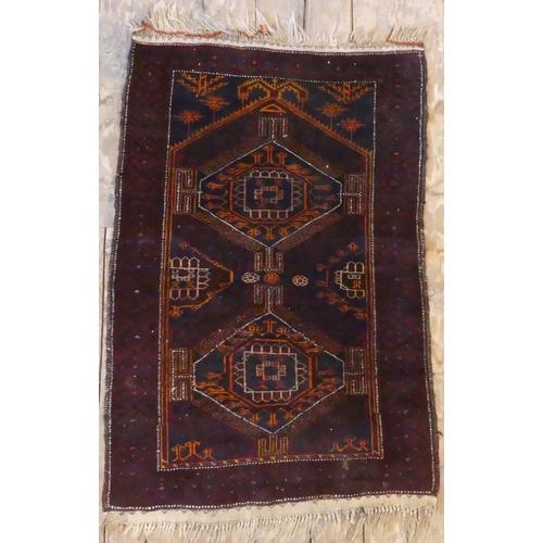334 - An old Middle Eastern prayer rug. UK Postage £20.