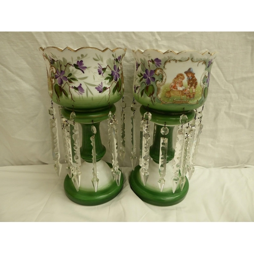 1 - A pair of milk glass and floral decorated lustres with cartouches showing children - ht. 37cm