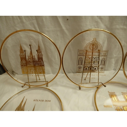 19 - Nine Orrefors limited edition glass plates with stands showing famous places of worship - diam. 25cm...