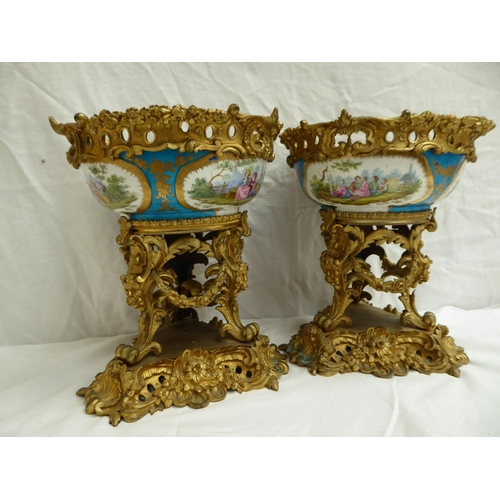 21 - A pair of gilt metal mounted Sevres style porcelain centre pieces on associated stands with foliate,...