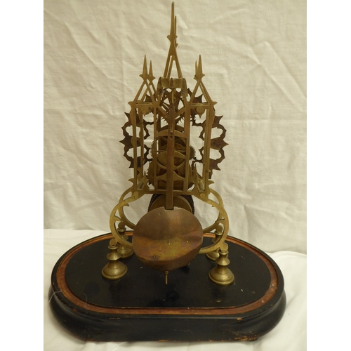 23 - Cathedral style brass skeleton clock with silvered dial, Roman numerals on a platform base - ht. 38c...