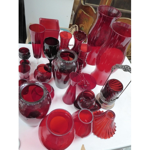 24 - A collection of ruby glass vases, shades, etc.