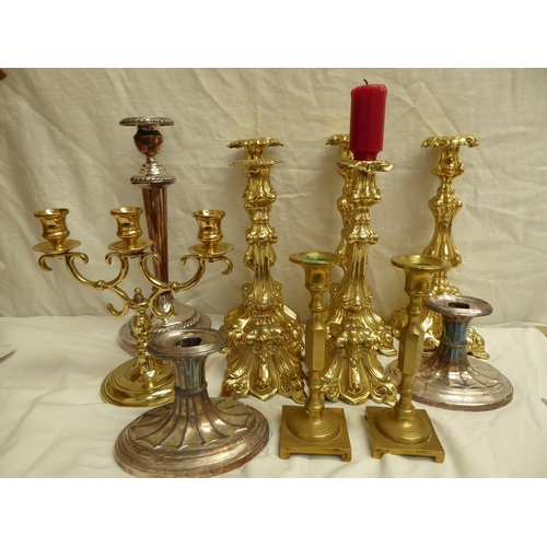 28 - Collection of numerous brass, metal and other candlesticks