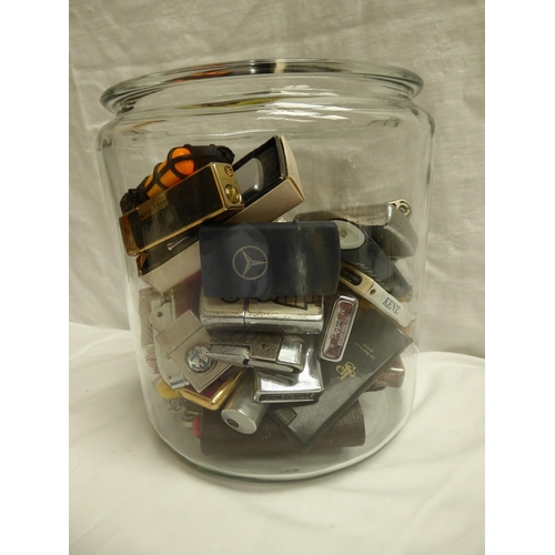 47 - A large jar of numerous gas and petrol lighters