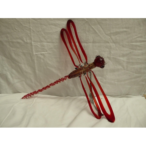 50 - A coloured glass mobile of a dragonfly - length 40cm., width 40cm