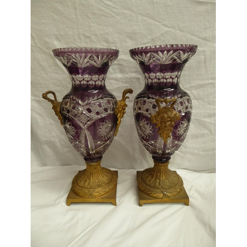 51 - A pair of ormolu mounted mauve cut glass twin handled bases with Bacchus masks - ht. 39cm