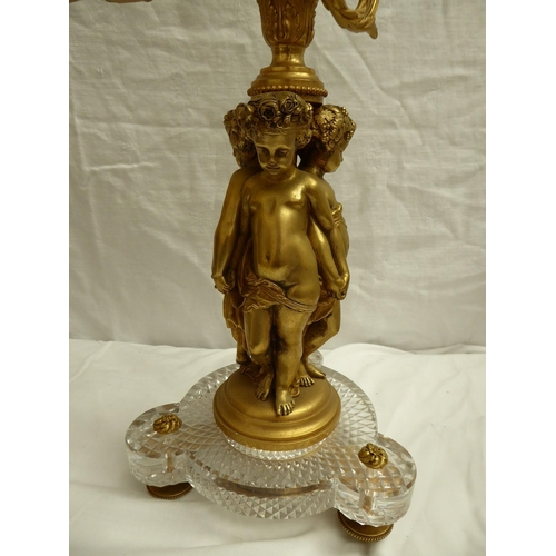 53 - A pair of Louis XVI style ormolu and glass seven branch candelabra with putti columns - ht. 64cm