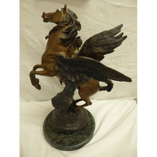 59 - Reproduction of a bronze of Pegasus by E. Picault on a green figured marble base - ht. 52cm