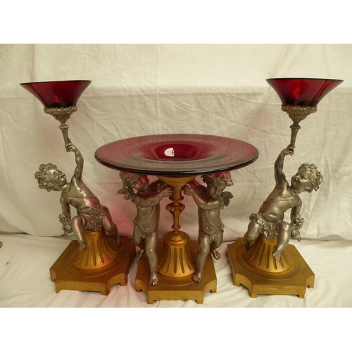 60 - An Empire style gilt metal and silvered ruby glass centre piece and side pieces with cherub supports...
