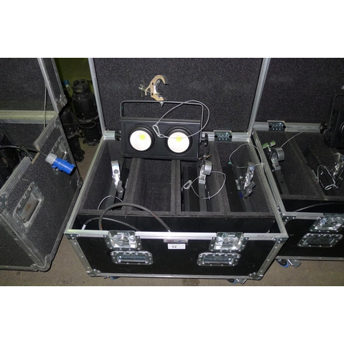 12 - 4 LED lights by Prolight type eLumen8, 200w, 3200k Blinder, 240v, contained in a wheeled flight case...
