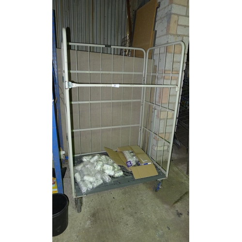 32 - 1 wheeled cage containing bandages and wall tidys - cage and contents are included...