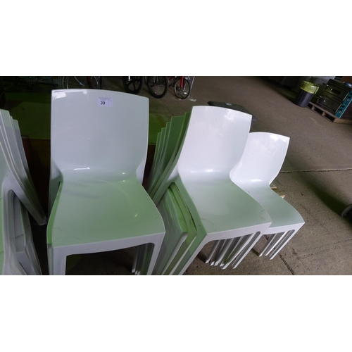 39 - 15 white plastic stacking chairs...