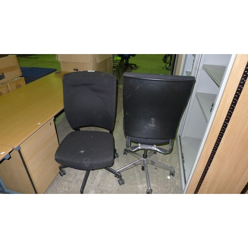 1023 - 2 black upholstered office swivel chairs...