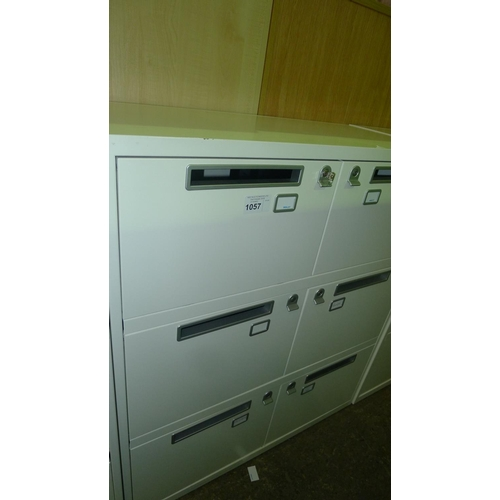 1057 - 1 cream metal 6 person personnel locker with post slot doors supplied with all keys...