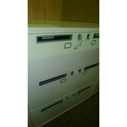 1058 - 1 cream metal 6 person personnel locker with post slot doors supplied with all keys...
