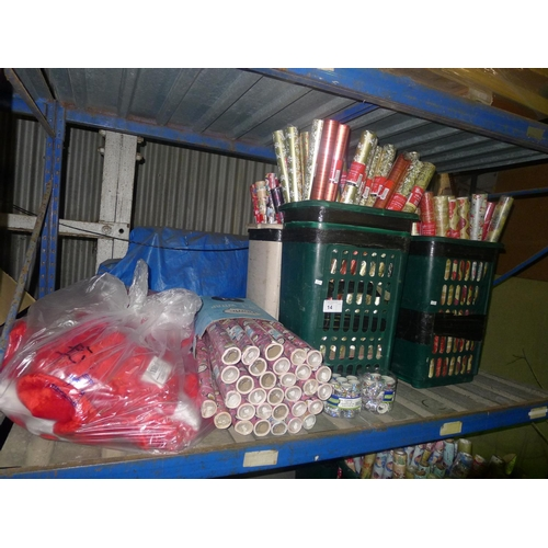 14 - A quantity of various Christmas related items wrapping paper, ribbon etc. Contents of one shelf...