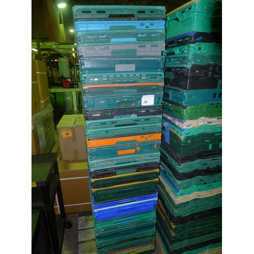 35 - A quantity of approx 25 various plastic crates with fold over stacking bars...