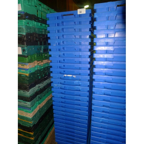 38 - A quantity of approx 27 blue plastic stacking crates on a mobile skate...