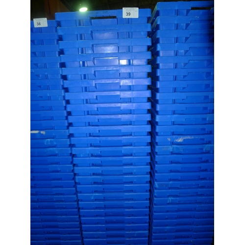 39 - A quantity of approx 27 blue plastic stacking crates on a mobile skate...