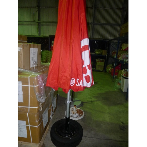 56 - 1 parasol with car wheel base and