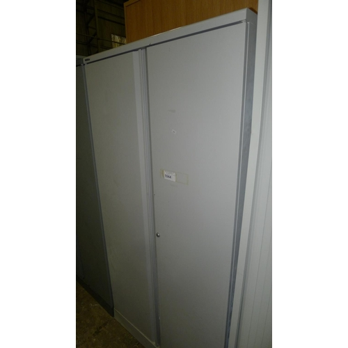 1044 - 1 light grey metal 2 door storage cabinet approx 6 by 3 foot...
