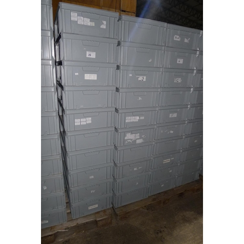 29 - 20 grey plastic stacking boxes...