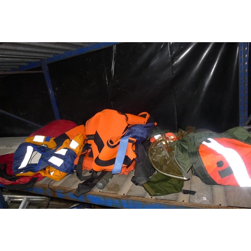 4 - A quantity of various protective clothing including 1 immersion suit, 1 dry suit, several life jacke...