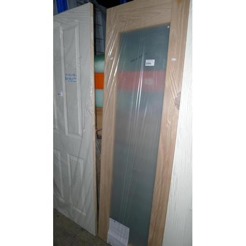 2006 - 1 oak veneer single pane glazed door approx 1982mm x 610mm...