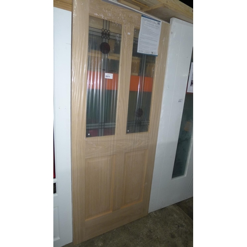 2011 - 1 oak veneer door by Jeld Wen with 2 decorative glass panes fitted approx 1981mm x 840mm...