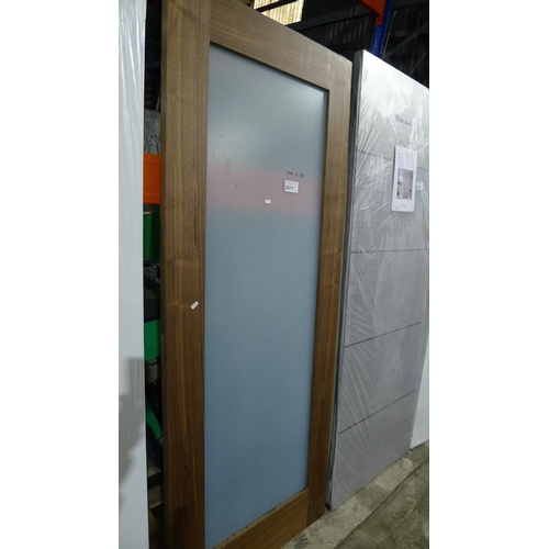 2017 - 1 dark wood door with 1 long glass pane fitted approx 762mm x 1982mm...
