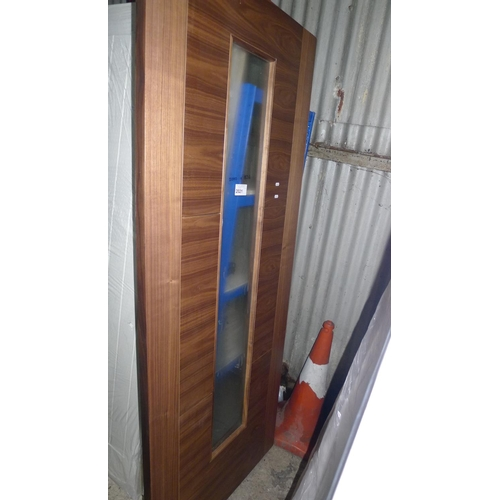 2021 - 1 dark wood door with 1 long glass pane fitted approx 2040mm x 826mm...
