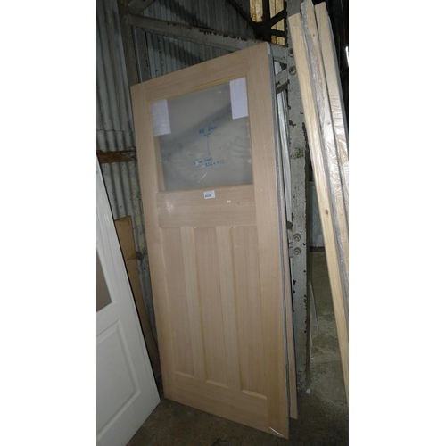 2029 - 2 oak doors each approx 836mm x 1982mm - both doors require 1 glass pane but no glass is included...