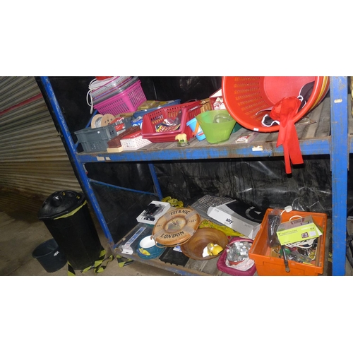 1 - A quantity of various household items including a digital photo frame, plastic baskets etc. Contents...