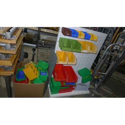 21 - A quantity of Lin type plastic storage bins & a double sided storage bin hanging rack...