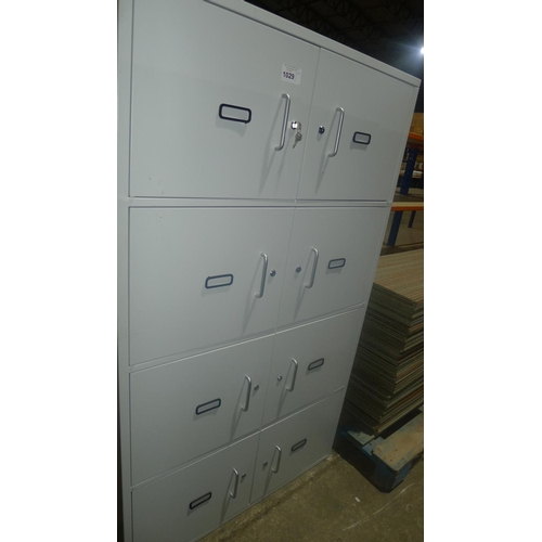 1029 - A grey metal 8 door personnel type locker supplied with all keys...