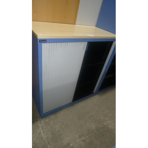 1046 - 1 blue metal low shutter front cabinet with wood effect top by Triumph...
