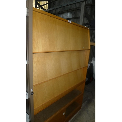1053 - 1 wood effect literature cabinet with several lift up and push back shelf fronts...