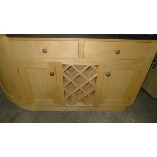2350 - 1 wooden kitchen island with a circular wooden worktop, a shaped black granite worktop, various door...