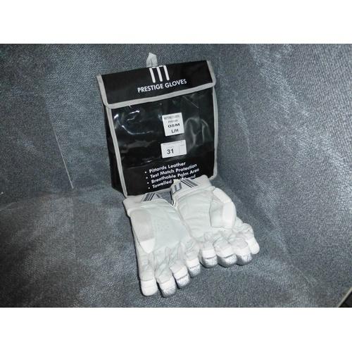 31 - A pair of Macer Prestige batting gloves size OSM L/H...