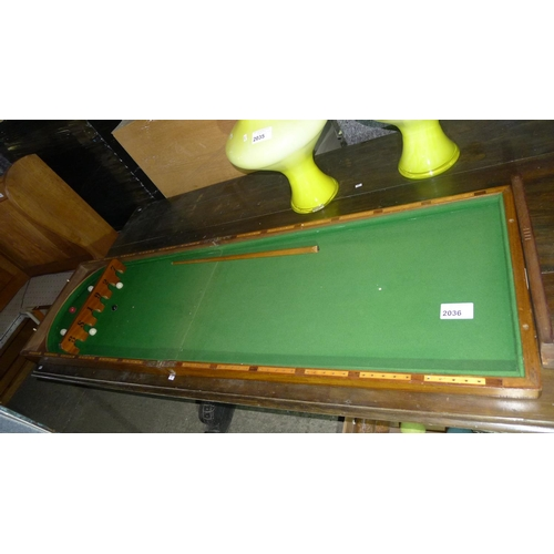 2036 - A vintage mahogany folding bar billiards table with balls.. 36
