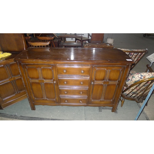 2042 - A dark wood Ercol sideboard with two cupboards and 4 drawers, 147cm wide...