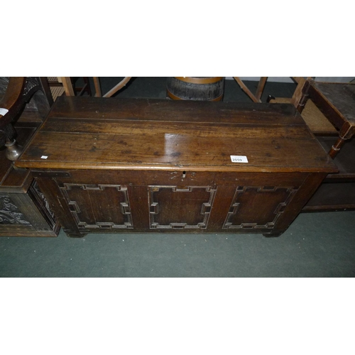 2059 - An old oak coffer with a lift lid, 124cm wide...