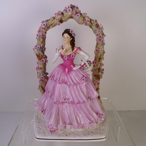 124 - A Royal Worcester figurine of a lady
