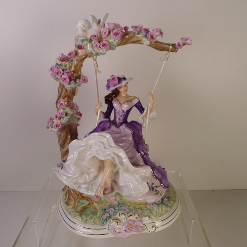 125 - A Royal Worcester figurine of a lady on a swing