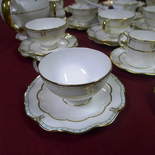 333 - A Royal Crown Derby Lombardy tea and coffee service comprising; coffee pot, tea pot, 2 sugar basins,...
