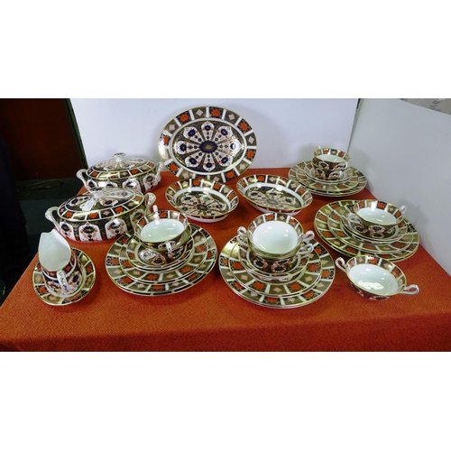 334 - A Royal Crown Derby old Imari 1128 dinner service comprising; 2 tureens, gravy boat & saucer, oval m...